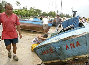 Fishermen in Havana secure their boats