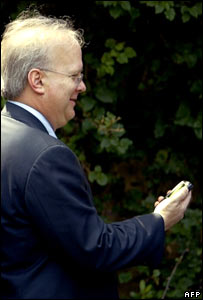 White House adviser Karl Rove and his Blackberry