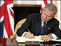 George W Bush signing book of condolences at the UK embassy in Washington