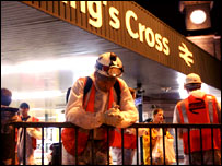 A construction worker says a prayer at King's Cross