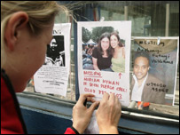 Putting up missing persons posters