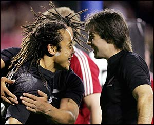 Tana Umaga celebrates with fellow try-scorer Conrad Smith