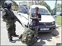 Security personnel check cars in Colombo