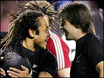 All Blacks captain Tana Umaga (left) and centre Conrad Smith celebrate