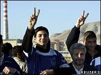 Iranian athletes flash victory signs at protest outside nuclear facility in Isfahan, Iran