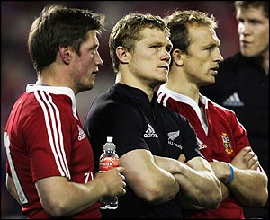 Ronan O'Gara, Josh Lewesy and Matt Dawson stand dejected after the Lions' defeat