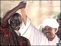 New Sudanese Vice-President John Garang and President Omar al-Bashir