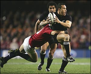 Rico Gear is tackled by Matt Dawson