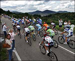 The peloton winds its way through the Black Forest in southern Germany