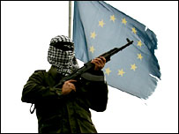 A Palestinian gunman on the roof of the EU office in Gaza