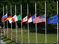 Flags of the G8 nations flying at half-mast