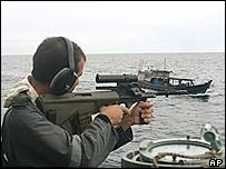 An Australian navy officer fires a warning shot at an Indonesian fishing boat (file pic)