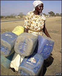 An elderly woman from Longonot Naivasha, Kenya carries her water jerricans along the Naivasha-Mai Mahiu road in search of water due to the drought in the area