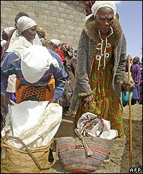 Elderly women wait to receive food rations from government officers in Suswa, Kenya