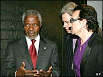 Kofi Annan, Bob Geldof and Bono exchange views at Gleneagles