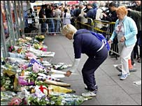 Mourners leave flowers outside Kings Cross station, London