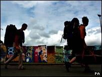 Campers leaving G8 eco-village site