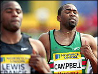 Darren Campbell (right) shows his disappointment after failing in the 100m