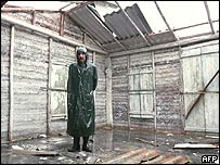 A Cuban man stands in the remains of his home in Union de Reyes, Cuba