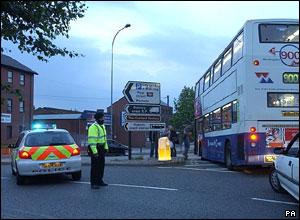 Policeman diverting traffic