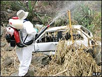 A man sprays insecticide against mosquitoes in Reunion