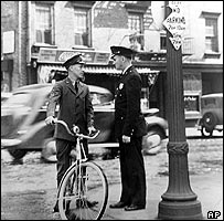 Western Union courier talks to a policeman