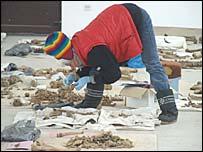 Dr Klonowski examining bone fragments