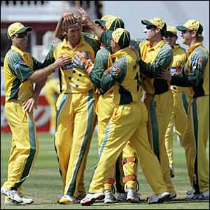 Australia mob Glenn McGrath as he gets the second wicket of the morning