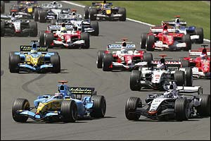 Montoya (front right) overtakes Fernando Alonso
