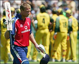 Flintoff hits a huge six to bring up England's 100 but his team are still in trouble