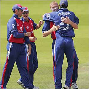 Flintoff is congratulated as he gets the wickets England need