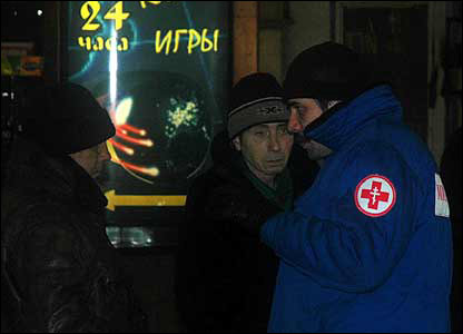Mercy worker examines two vagrants seeking aid at Kursk Station