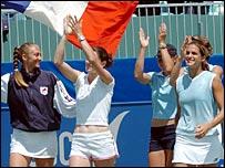 Mary Pierce, Nathalie Dechy, Severine Beltrame and Amelie Mauresmo celebrate France's victory