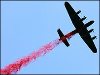 Lancaster bomber dropping poppies