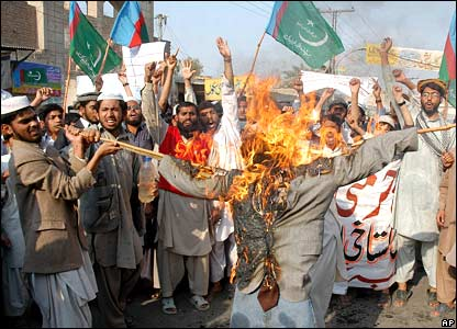 Protesters burn an effigy of Danish Prime Minister Anders Fogh Rasmussen, in Multan, Pakistan