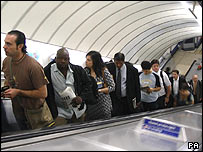 Commuters on escalator