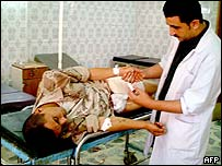A doctor checks the wounds of an Iraqi soldier at the emergency room of a local hospital in the city of Baquba