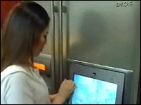 A woman using an internet fridge