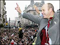 Sir Clive Woodward celebrates with the England fans on the parade through London after winning the 2003 Rugby World Cup