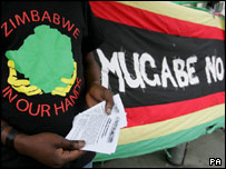 Anti-Mugabe protester outside Zimbabwe Embassy, London