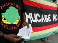 Anti-Mugabe protester outside Zimbabwe Embassy, London