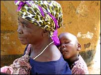 A Zambian woman with her grandchild on her back