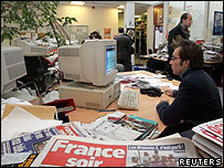 A journalist in the France Soir newsroom