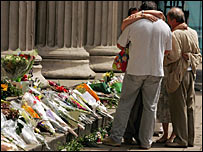 Mourners laying flowers for the dead