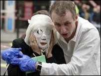Injured passenger taken away after London bombings