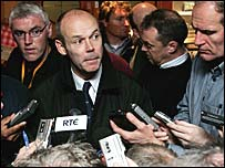 Woodward faces the media scrum after the first Test defeat