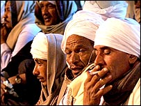 Men wait at Safaga port for news of passengers aboard the sunk ferry