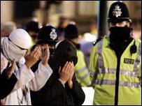 Muslim demonstrators pray outside the French embassy in London