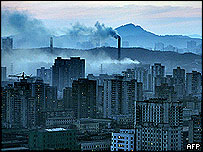 A view of the North Korean capital Pyongyang shows heavy pollution from coal powered power plants, 24 March 2005