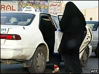 Saudi women gets into a taxi in Riyadh.
